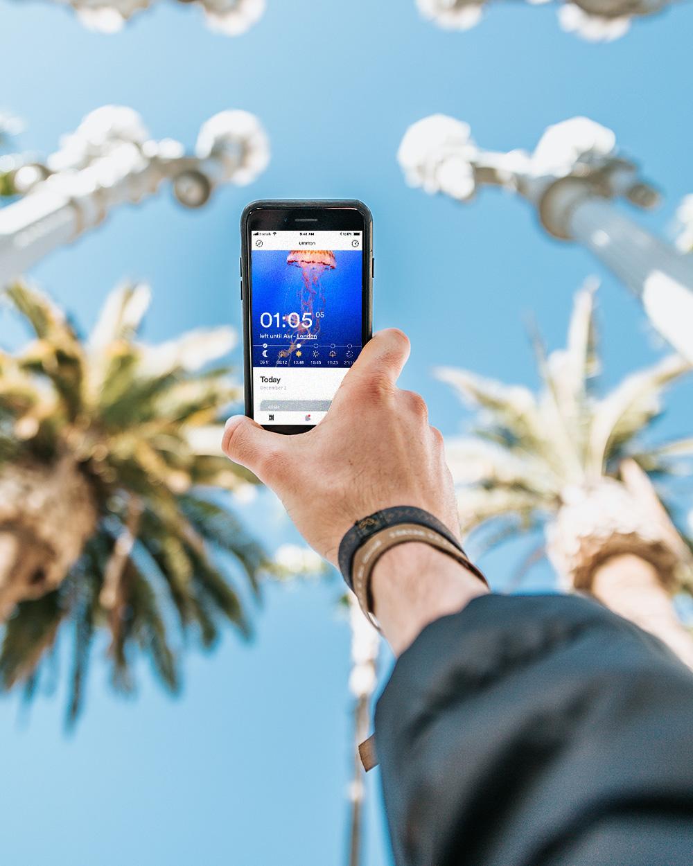 Holding ummah app on hand